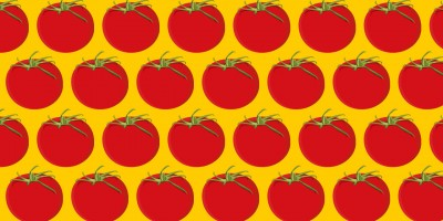 Muster aus Tomaten auf gelbem Grund