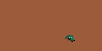 Ein kleiner Traktor auf einem sehr großen Feld.