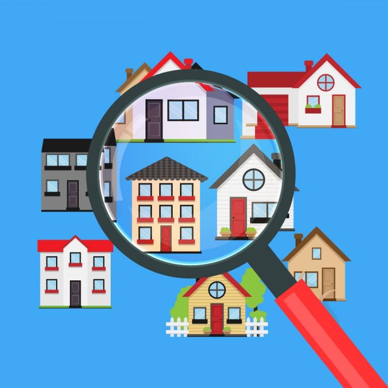 Eine Vergrößerungsglas über verschiedenen Arten von Häusern